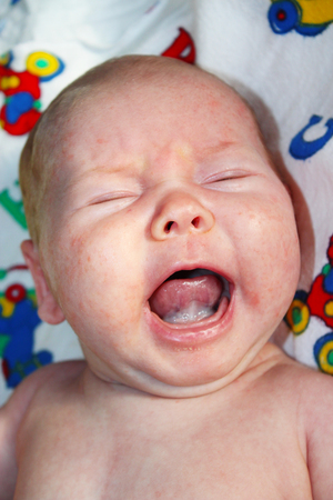 little lovely baby crying on the bed Stock Photo