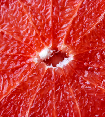 sappy: grapefruit bright red and cut by segments