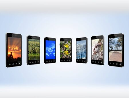 phone isolated: Modern mobile phones with different images