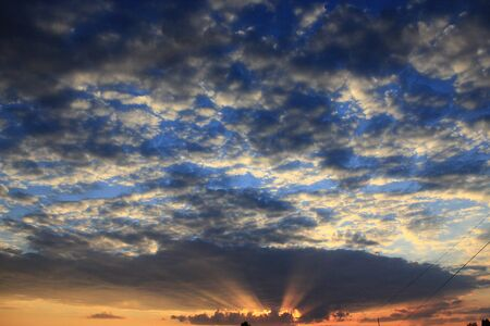 the decline: beautiful summer decline with dark sky and the last sun beams