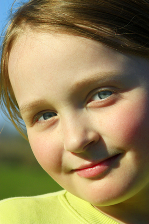 nice face: portrait of little beautiful girl with nice face and blue eyes