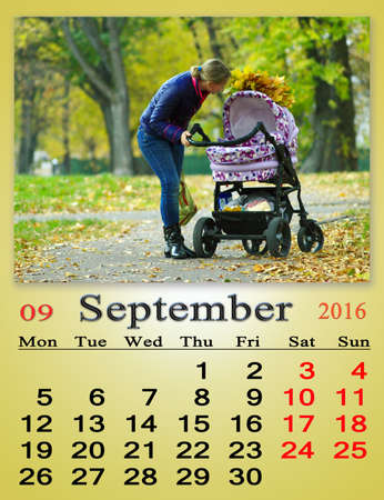 perambulator: calendar for September 2016 with woman and perambulator in Autumn park