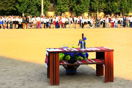hand bell: festive hand bell on the table on the holiday of first bell on the 1st September 2016. Holiday of knowledge in Chernihiv town Ukraine