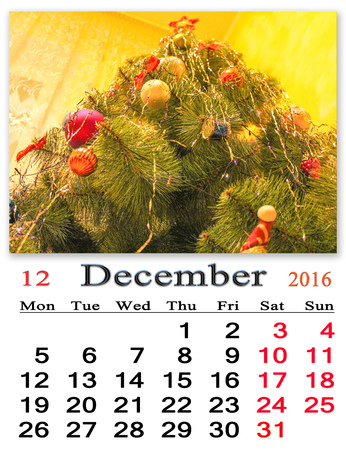 newyear: calendar for December 2016 with New-Year tree decorations Stock Photo