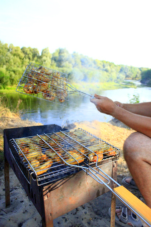 appetizing: appetizing barbecue from hens meat cooking in the nature Stock Photo