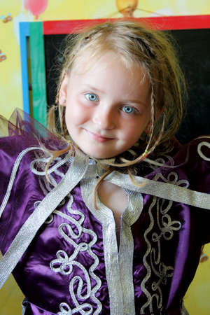sympathetic: little blue-eyed sympathetic girl in an Moroccan suit