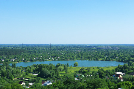 beautiful view to country houses at picturesque lake Imagens