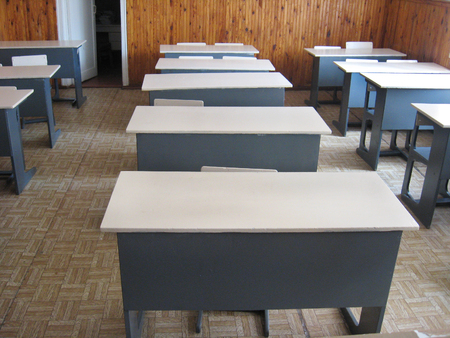 light classroom with a lot of desks 스톡 콘텐츠