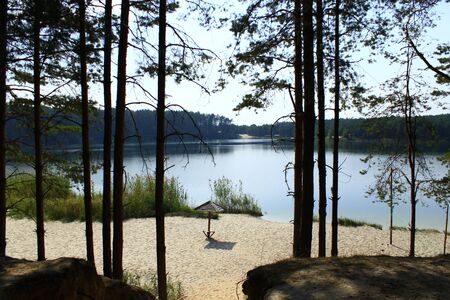 lake beach: beautiful summer landscape with picturesque lake with sandy coast in the forest Stock Photo