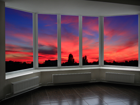 beyond: big office windows with beautiful sunset beyond it