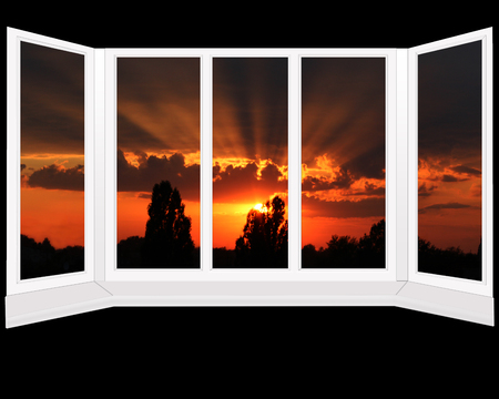 urban decline: big office windows with beautiful sunset beyond it. Isolated on the black background Stock Photo