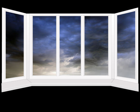 night view: windows with dark thunder clouds beyond it. Modern window isolated on the black