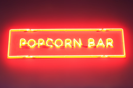plate popcorn made from red neon lights on the wall Imagens