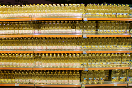 sunflowerseed: bottles with sunflower-seed oil made by Ukrainian agrocultural firms on the shelf of shop