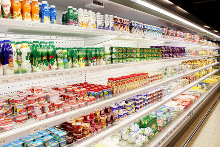 milk products: yoghurt and others dairy produce on the shelves of shop
