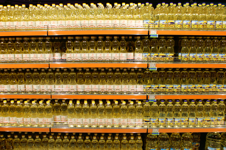 sunflowerseed: sunflower-seed oil made by Ukrainian agrocultural firm Chumak  in the bottles on the shelf of shop