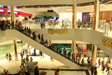 view of a staircase in a shop: people on the escalator in the supermarket in Chernihiv
