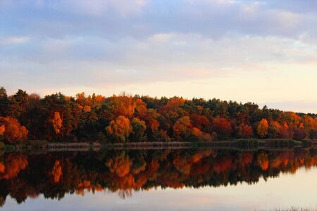 liquid reflect: beautiful landscape with river and autumn colored forest Stock Photo