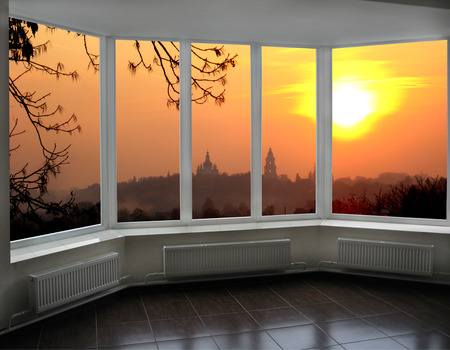 impassioned: plastic windows overlooking the beautiful fiery red sunset Stock Photo