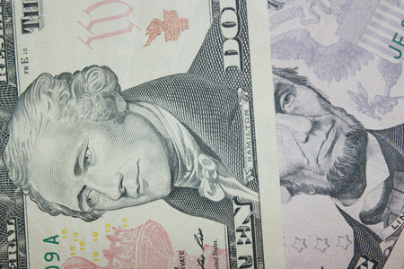 equivalent: dollar banknotes 5 and 10 with images of presidents