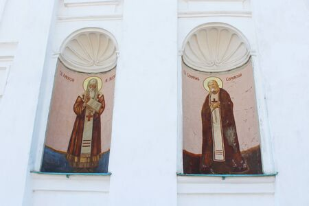 cross recess: images of two Saints on the Triytskyi temple wall in Chernihiv Stock Photo