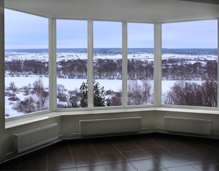 verandah: wide window of verandah overlooking the winter landscape