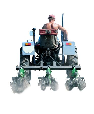 agronomic: man drives a tractor with special equipment for weed in agriculture isolated