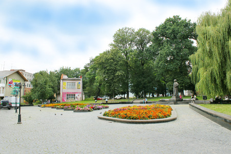 grassplot: life in nice street of Drohobych town with nice park in Western Ukraine Editorial