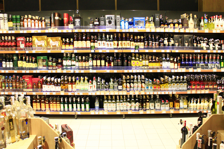 alcoholic drinks: alcoholic drinks on the shelves of supermarket