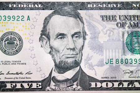 equivalent: five dollars banknote with image of Abraham Lincoln