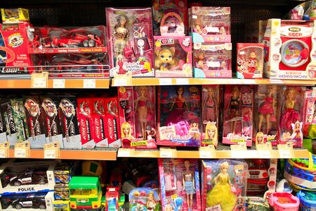 toy shop: many dolls on the shelves of toy shop Editorial