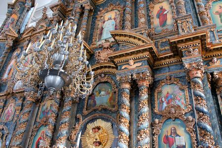 iconostasis: beautiful iconostasis with ancient icons set in wooden frame. Religious work of art in the church Editorial