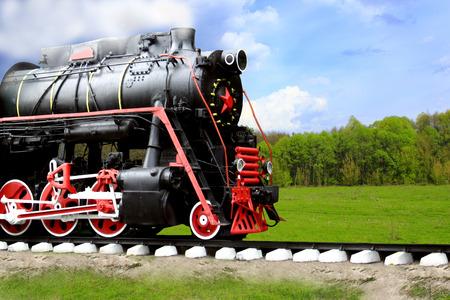 black steam locoAncient black steam locomotive goes fast in the fieldmotive goes fast Stock Photo