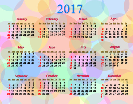 next year: calendar for next 2017 year on the multicolored rings and circles Stock Photo