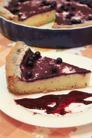 bilberry: piece of pie with bilberry on the plate is very delicious