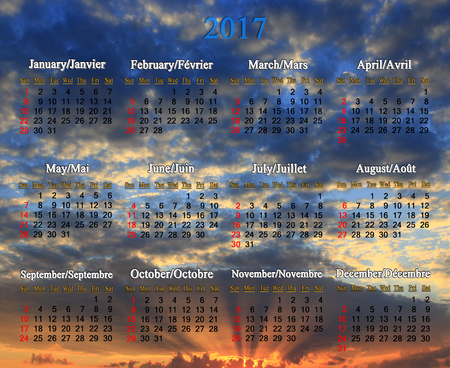 decline: office calendar for 2017 year in English and French on cloudy decline background