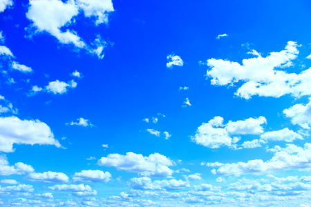 beautiful white clouds on blue sky background. White clouds on the summer sky