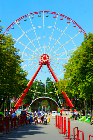 gorky: view to ferris wheel and people walk in Gorky park in Kharkiv