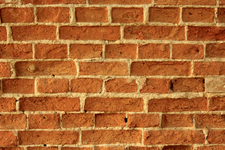 durable: wall made from red old durable bricks
