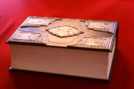 thick ancient book on the vintage table