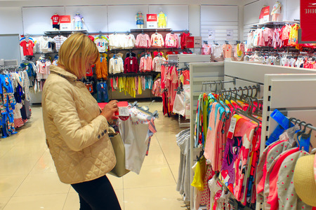 woman chooses clothes in the shop