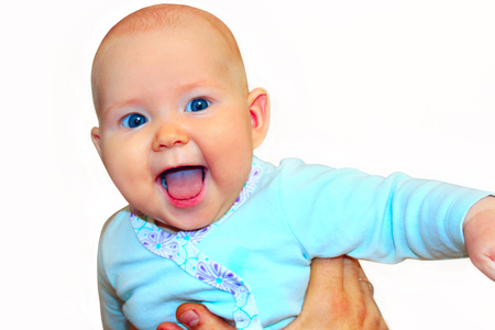 beautiful baby smiles on the hands isolated on the white. She looks like crying wow