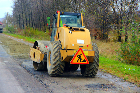 road-roller is ready to go on the asphalted road Stock Photo