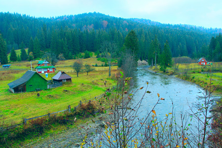 landscape with mountainous river flowing in the Ukrainian village in the forest of Carpathian mountains 版權商用圖片