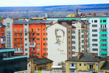 city view with a large graffiti with a portrait of Ivan Franko on the walls of a multi-storey house