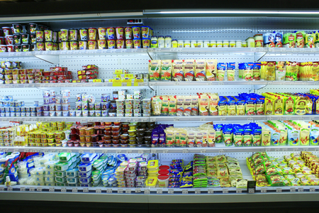 yogurts sour cream and others dairy produce on the shelves of shop