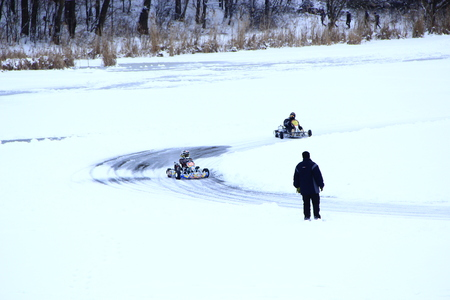 competitions of kart racing on the ice of Strizhen river in Chernihiv Editorial