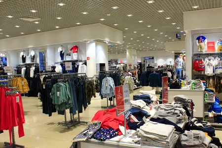Wide assortment in shop of outer clothing. Clothes in the supermarket Editorial