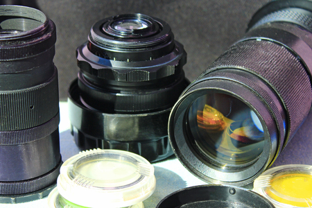 Photographic lens photofilters and other photo accessories. Photoalbum. Retro photo objectives Stock Photo