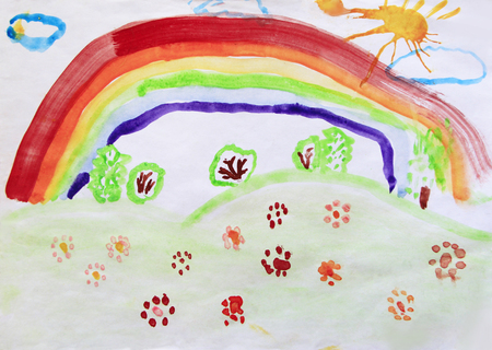 Childs drawing of clearing with flowers rainbow and colored bushes. Bright summer. Childish art. Artwork drawn by watercolors. Childrens drawing water color paints on paper